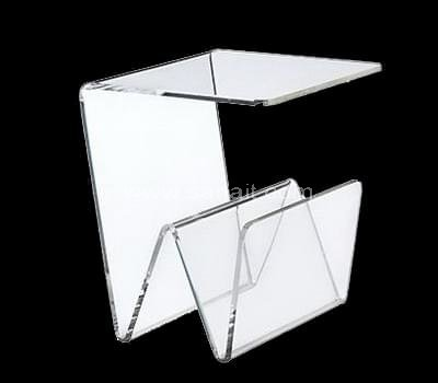 Lucite coffee table with magazine holder